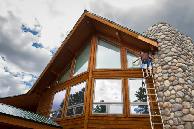 Cleaning third story windows near Durango Colorado.